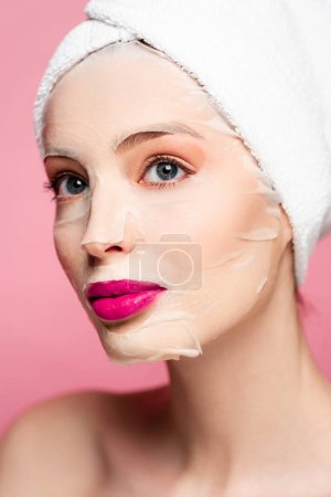 Photo pour Young naked woman in face mask isolated on pink - image libre de droit