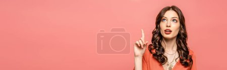 Photo for Panoramic shot of thoughtful young woman showing idea gesture while looking up isolated on pink - Royalty Free Image