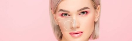 Photo for Panoramic shot of attractive tender girl with pink makeup, isolated on pink - Royalty Free Image