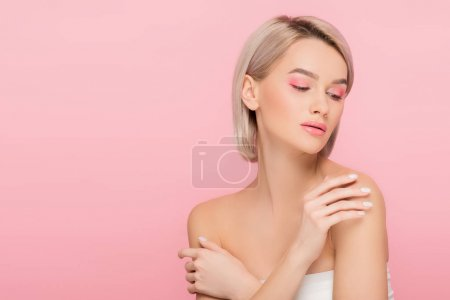 Photo for Blonde tender woman with pink makeup, isolated on pink - Royalty Free Image