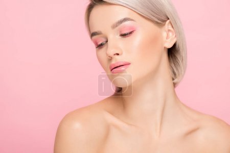 Photo pour Naked blonde girl with pink makeup, isolated on pink - image libre de droit