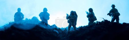 Photo for Battle scene of toy soldiers with smoke on blue background, panoramic shot - Royalty Free Image