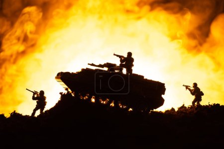Photo for Battle scene of toy tank and soldiers with fire at background - Royalty Free Image