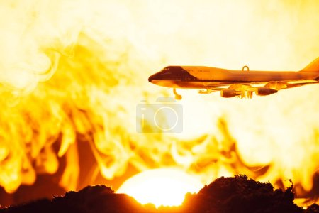 Photo for Battle scene with toy plane and fire with sunset at background - Royalty Free Image