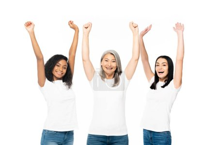 Photo for Cheerful multicultural women with hands above head celebrating isolated on white - Royalty Free Image