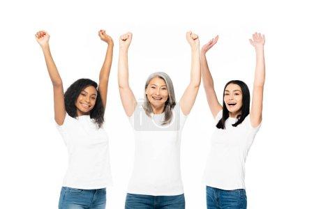 Foto de Mujeres multiculturales alegres con las manos por encima de la cabeza celebrando aislado en blanco - Imagen libre de derechos