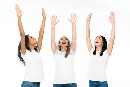 Photo pour Happy multicultural women with hands above head looking up isolated on white - image libre de droit