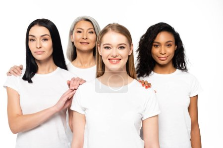 Photo for Happy multicultural women in white t-shirts looking at camera isolated on white - Royalty Free Image