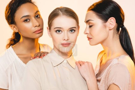 Photo for Three beautiful multicultural women with makeup isolated on beige - Royalty Free Image
