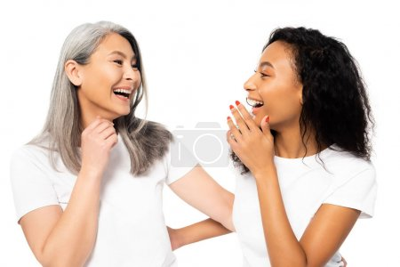 Photo pour Happy african american and asian women laughing isolated on white - image libre de droit