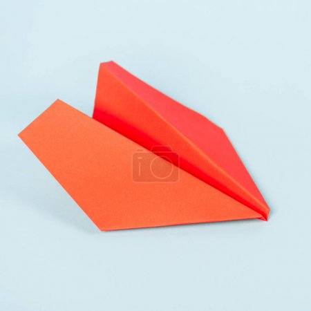 toy paper plane on blue with copy space