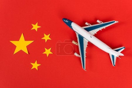 top view of toy airplane on red chinese flag
