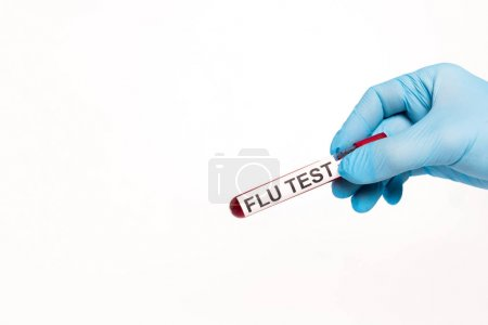 cropped view of scientist holding test tube with flu test lettering isolated on white