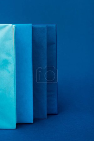 Photo for Bright books on blue background with copy space - Royalty Free Image