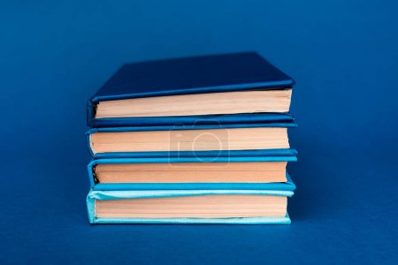 Photo for Bright and colorful books on blue background - Royalty Free Image