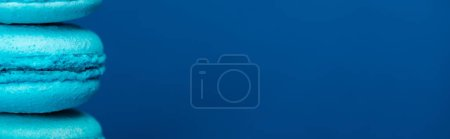 Photo for Panoramic shot of french macaroons isolated on blue with copy space - Royalty Free Image