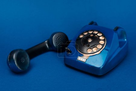 retro telephone on blue background with copy space