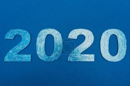 Photo for Top view of 2020 numbers isolated on blue - Royalty Free Image