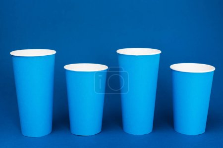 Photo for Colorful paper cups with soda on blue background - Royalty Free Image