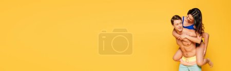 Foto de Foto panorámica de un hombre guapo y despiadado amigo de peluche aislado en amarillo. - Imagen libre de derechos