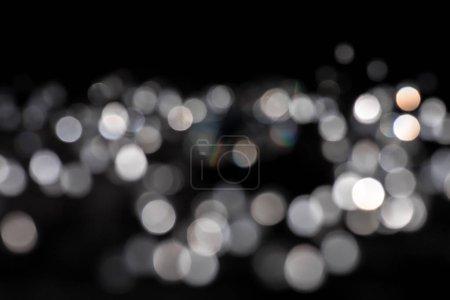 Photo pour Background of white bokeh on black background - image libre de droit