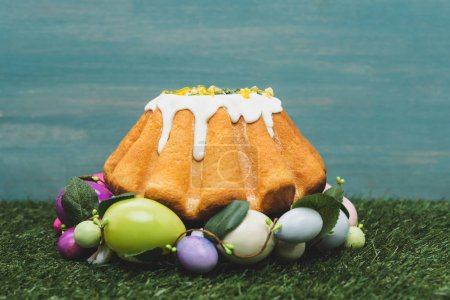 Photo for Easter cake in colorful decorative wreath on grass - Royalty Free Image
