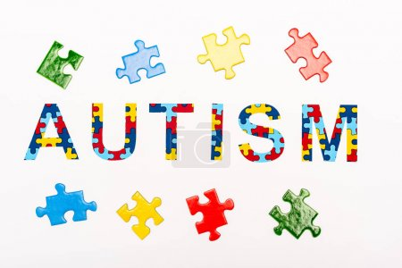 Photo for Top view of Autism puzzle lettering isolated on white - Royalty Free Image