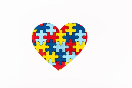 Photo pour Top view of puzzle heart isolated on white, autism concept - image libre de droit