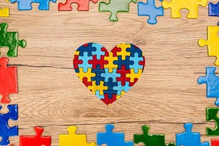 Photo for Top view of puzzle heart on wooden background, autism concept - Royalty Free Image
