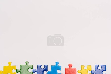 Photo for Top view of colorful pieces of puzzle isolated on white, autism concept - Royalty Free Image