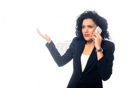 Photo for Worried african american woman talking on smartphone isolated on white - Royalty Free Image