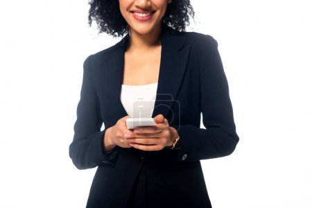 Cropped view of african american woman holding smartphone and smiling isolated on white
