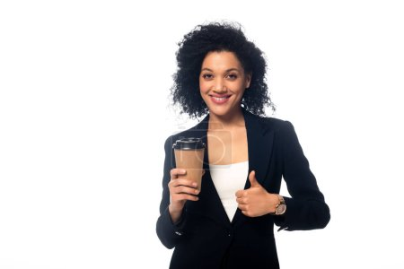 Front view of african american with disposable cup of coffee smiling and showing thumb up isolated on white
