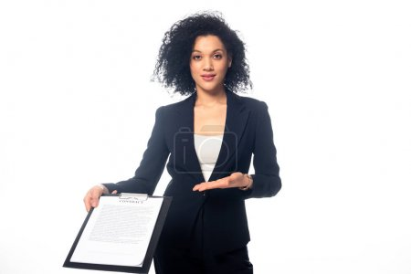 Photo for Front view of african american businesswoman looking at camera and showing contract isolated on white - Royalty Free Image
