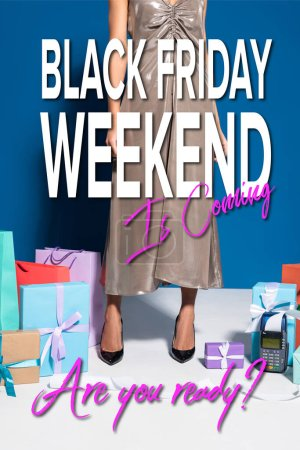 Photo pour Cropped view of african american woman in silver dress near payment terminal with check, shopping bags and gifts on blue background, black friday weekend illustration - image libre de droit