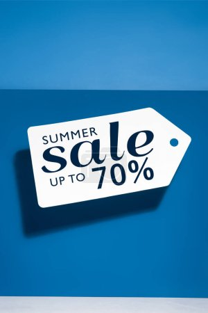 white big price tag with summer sale illustration on blue background