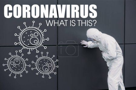 Photo pour Asian epidemiologist in hazmat suit leaning on wall while suffering from symptomatic abdominal pain, coronavirus illustration - image libre de droit