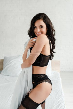 Photo for Beautiful happy seductive girl in black lingerie in bedroom - Royalty Free Image