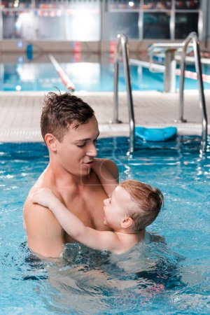 Photo for Swim coach teaching cute toddler boy in swimming pool - Royalty Free Image