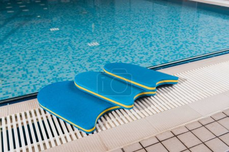 Photo pour Blue flutter boards near swimming pool in sports center - image libre de droit
