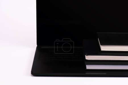 Photo for Notebooks on modern laptop with blank screen on white - Royalty Free Image