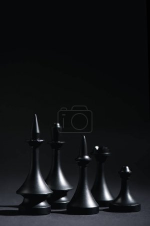 Photo for Chess figures on black with copy space - Royalty Free Image