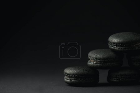 Photo for Dark and sweet macarons on black with copy space - Royalty Free Image