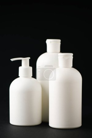 Photo for White bottles with cosmetics isolated on black - Royalty Free Image