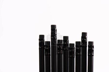 Photo pour Vue de dessus des crayons noirs avec gommes isolées sur blanc - image libre de droit