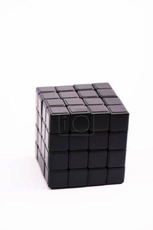 Photo for KYIV, UKRAINE - FEBRUARY 21, 2020: selective focus of black rubik cube isolated on white - Royalty Free Image
