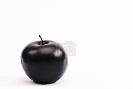 Photo for Black and nutritious apple on white with copy space - Royalty Free Image