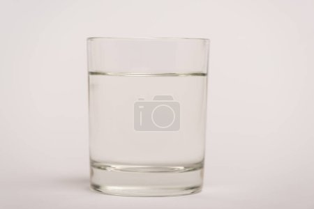 Photo for Close up view of glass of water on white surface - Royalty Free Image