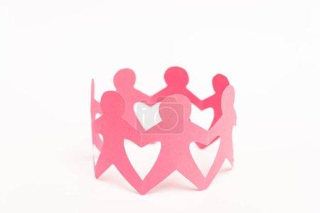 Photo pour Figures en papier rose de personnes tenant la main sur fond blanc - image libre de droit
