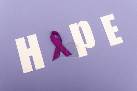 Photo for High angle with of word hope with purple ribbon isolated on purple - Royalty Free Image